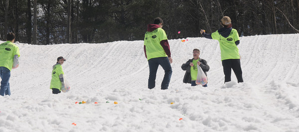 Amesbury: Volunteers from Boy Scout Troop 21 in Newburyport spead eggs on the snow at the Egg Drop-Palooza at Amesbury Sports Park to benefit Lucy's Love Bus, a local nonprofit now helping young cancer patients in 12 states. Jim Vaiknoras/staff photo