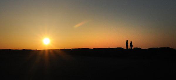 Salisbury: Two people enjoy the sunrise on Salisbury Beach Sunday. Jim Vaiknoras/staff photo