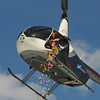 Amesbury: A helecopter from the NorthAndover Flight Academy lets go of its payload at the Egg Drop-Palooza at Amesbury Sports Park to benefit Lucy's Love Bus, a local nonprofit now helping young cancer patients in 12 states. Jim Vaiknoras/staff photo
