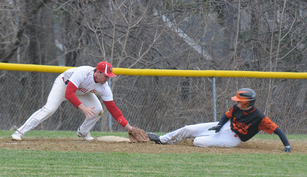JIM VAIKNORAS/Staff photo Amesbury third baseman Zachary Fitzgerald tags out Ipswich's Ryan Silva during their game at Amesbury friday.