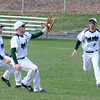 JIM VAIKNORAS/Staff photo  Pentucket's Ryan Kuchar makes a catch between teammates, Keinan Haley , left and John Sirios during their game against Triton at Pentucket in West Newbury.