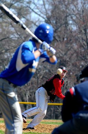 JIM VAIKNORAS/Staff photo Amesbury's Samuel Burnham pitches against Georgetown Saturday morning at Amesbury high.