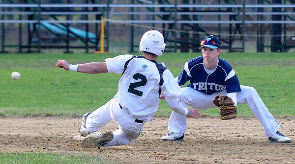 JIM VAIKNORAS/Staff photo  Triton's Justin Cashman waits for the throw as Pentucket's DJ Englke during their game at Pentucket in West Newbury Thursday .