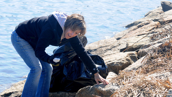 JIM VAIKNORAS/Staff photo Katchen Witner picks up trash along teh Merrimack River in Newburyport Saturday. She was  amounst the more than 50 volunteers to help out in the annual Clean Sweep through out Newburyport.