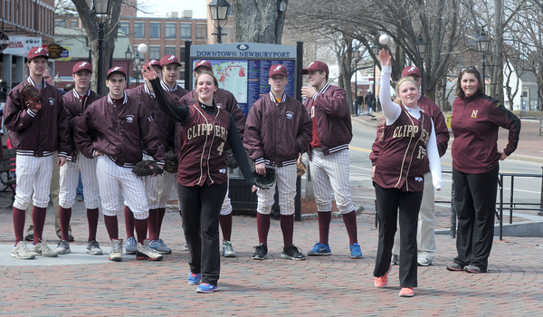 """JIM VAIKNORAS/Staff photo  <br />  Players on the Newburyport high baseball look on as  softball players Victoria Allman and Carley Siemasko toss out the """"First Pitch"""" in Market Square in Newburyport Friday. The event was in honor of the Red Sox home opener."""