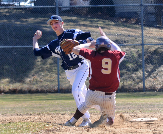 JIM VAIKNORAS/STaff photo  Newburyport's Travis Wile slides into second as Triton's Bradley Whitman turns a double play during their game at Pettengill Field in Newburyport Saturday.