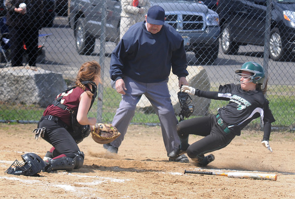 JIM VAIKNORAS/Staff photo  Newburyport's Newburyport catcher Jade Carpenter tags out  Pentucket's Maddie Binding at home during their game at Cashman Park in Newburyport. Newburyport won the game 7-4.