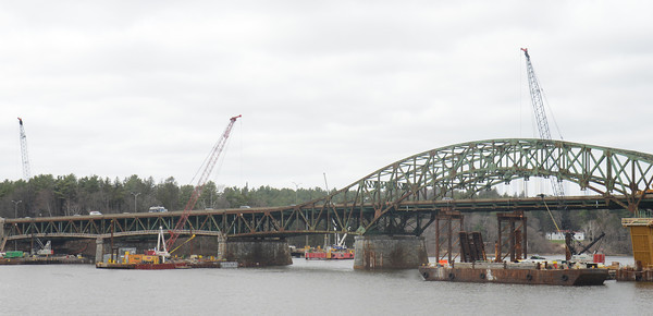 JIM VAIKNORAS/Staff photo Barges fill the Merrimack River as work continues on the Whittier Bridge.