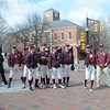 JIM VAIKNORAS/Staff photo  <br /> Players on the Newburyport high baseball and softball teams in Market Square in Newburyport Friday to Mayor Donna Holaday and Scott Eaton of teh Newburyport Five Cent Savings Bank. The event was in honor of the Red Sox home opener.