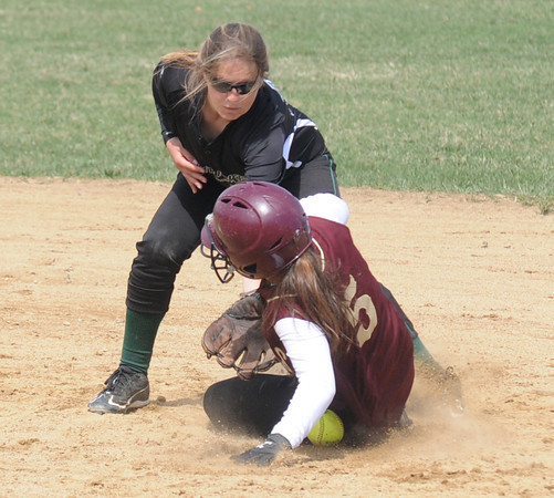 JIM VAIKNORAS/Staff photo  Newburyport's Meghan Stanton slides safely into second under the tag of Pentucket's  Kassidy Kennefick during their game at Cashman Park in Newburyport. Newburyport won the game 7-4.