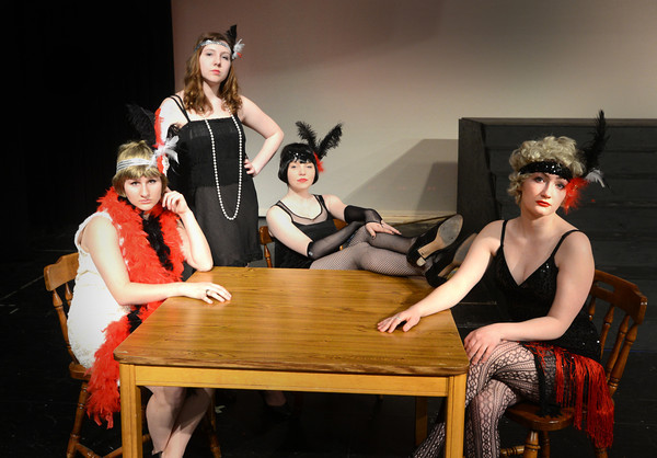 JIM VAIKNORAS/Staff photo  Aspen Gibbas as Mama Morton, Haley Gendell as Mary Sunshine, Kayla Murphy as Velma Kelly , and Charlotte Hyde as Roxie Hart in the Amesbury high School production of Chicago.