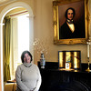 JIM VAIKNORAS/Staff photo   New Executive Director of the Historical Society of Old Newbury Susan Edwards poses next to a portait  of Caleb Cushing in the Oriental Room at the Cushing House in Newburyport.