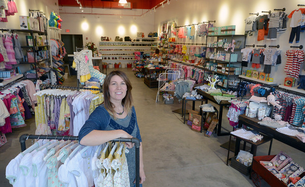 JIM VAIKNORAS/Staff photo Kim Lively at her new store in Lynnfield
