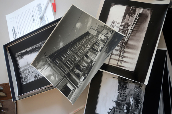 JIM VAIKNORAS/Staff photo Photos waiting to be scanned in at the  for the Newburyport 250th book. If you have photos of Newburyport bring them to the Daily News on Liberty Street this Tuesday from 3-5 pm and this Thursday from 10am-1pm.