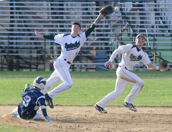 JIM VAIKNORAS/Staff photo  Triton's Michael Talbot safely steals second base as Pentucket's Kiernan Haley can't quite reach the throw during their game at Pentucket in West Newbury. Short stop DJ Englke backed up the play holding Talbot at second.