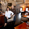 JIM VAIKNORAS/Staff photo. Nancy Batista-Caswell and chef Patrick Soucy sit at teh bar on the third floor of Ceia on State Street in Newburyport, they recently won a couple of Rising Star Awards.