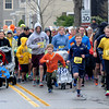 JIM VAIKNORAS/STaff photo Runner take off on Merrimac Street in Newburyport for the Greater Newburyport Boston Strong Run. the race sponsored by the Winner Circle Running Club raised money for the One Fund.