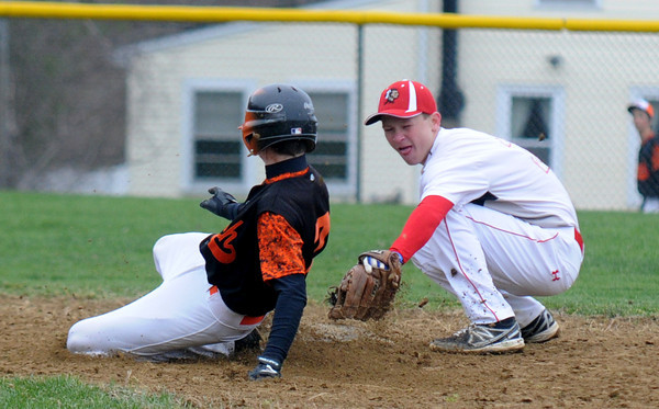 JIM VAIKNORAS/Staff photo  Amesbury's Jared Dupre tries to get the tag down as a Ipswich's Erik Gongasslides into second during their game at Amesbury Friday.