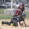 JIM VAIKNORAS/Staff photo  Newburyport's Meghan Stanton slide into home plate as the ball is late getting to Pentucket's Maddie Binding during their game at Cashman Park in Newburyport. Newburyport won the game 7-4.