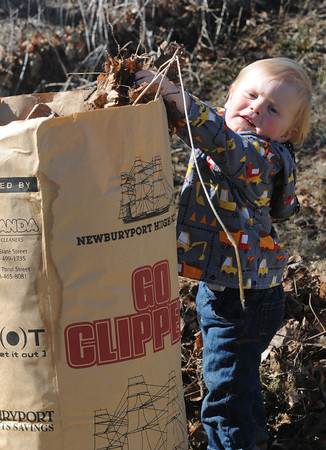 JIM VAIKNORAS/Staff photo Griffin Dardinski , 2, fills a bag with leaves as he helps clean Cashman Park Saturday. He was amounst the more than 50 volunteers to help out in the annual Clean Sweep through out Newburyport.