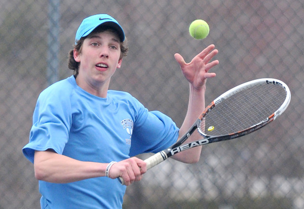 JIM VAIKNORAS/Staff photo Triton tennis player John DiDonato  returns the ball during his match with Amesbury's Cooper Wigglesworth Friday at Amesbury High.