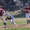 JIM VAIKNORAS/STaff photo   Triton's Justin Cashman gets caught in rundown bty Newburyport's #9 Travis Wile and Matthew Short  during their game at Pettengill Field in Newburyport Saturday.