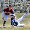 JIM VAIKNORAS/STaff photo   Triton's Adam Chatterton slides safely back to 3rd just under the tag of Newburyport's  William Cataldo during their game at Pettengill Field in Newburyport Saturday.