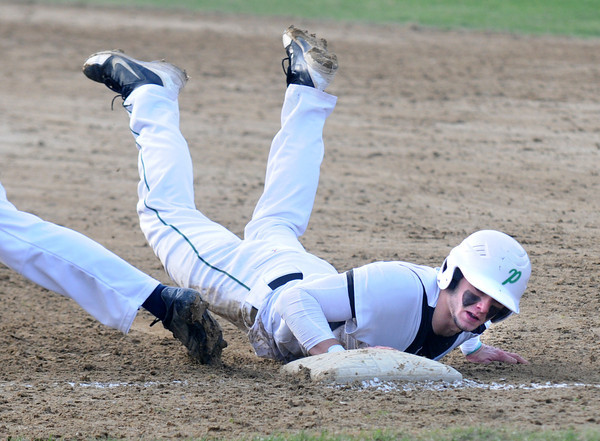 JIM VAIKNORAS/Staff photo   Pentucket's DJ Englke dives back to first on a pick off play during the Sachem's home game aganst Triton in West Newbury.