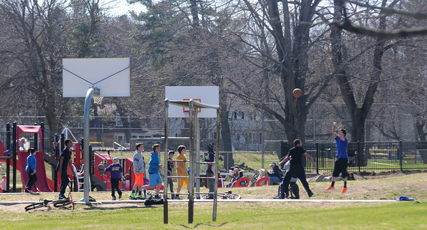 JIM VAIKNORAS/Staff photo  Kids enjoy a game of basketball in the bright sunshine Thursday at Amesbury Park.