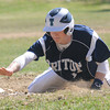 JIM VAIKNORAS/STaff photo  Triton's Justin Cashman dives back to first against Newburyport at Pettengill Field in Newburyport Saturday.