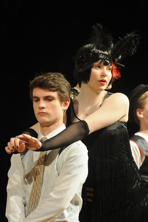 JIM VAIKNORAS/Staff photo Jack Labbe as Billy Flynn and Kayla Murphy as Velma Kelly  in the Amesbury high School production of Chicago.