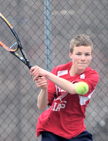 JIM VAIKNORAS/Staff photo Amesbury tennis player Cooper Wigglesworth returns the ball during his match with Triton John DiDonato Friday at Amesbury High.