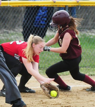 BRYAN EATON/Staff Photo. Newburyport's Lauren Singer slides into third base past Amesbury's #22.