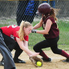 BRYAN EATON/Staff Photo. Newburyport's Lauren Singer slides into third base past Amesbury's #22.