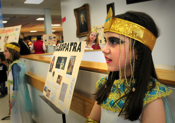 BRYAN EATON/Staff Photo. Madison Catanzariti, 10, takes on the role of Cleopatra at the Museum of Wax at the Cashman School in Amesbury yesterday. Students chose people from history and researched them, created costumes and then made presentations to parents and schoolmates.