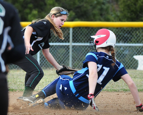 BRYAN EATON/Staff Photo. Triton's Mara Speare is safe at second before Pentucket's Kassidy Kennefick makes the tag.