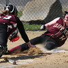 BRYAN EATON/ Staff Photo. Newburyport's Amy Sullivan comes in short as she slides into home plate.