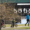 BRYAN EATON/ Staff Photo. Many people were out at Cashman Park and here on the Harborwalk in Newburyport on Monday morning as the temperature started to rise.