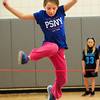 BRYAN EATON/ Staff Photo. Paige Hathaway, 8, clears jump rope used as a high jump at Salisbury Elementary School on Tuesday. She was in Linda Gangemi's intramural track and field events afterschool.