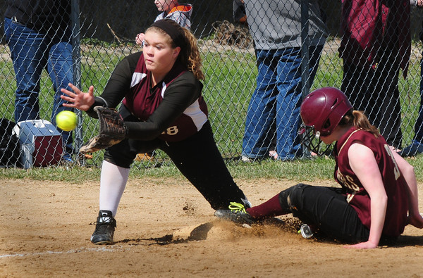 BRYAN EATON/ Staff Photo. Newburyport's Molly Kelley slides safely into third as the Chelmsford baseman waits for the throw.