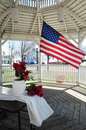 BRYAN EATON/ Staff Photo. Rosemary Werner and others put up a memorial at the gazebo in downtown Amesbury to encourage anyone who would like to remember the Boston Marathon bombing and write something in the book of remembrance. The book will be sent to Boston Marathon Memorial at the Boston Public Library.