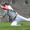 BRYAN EATON/ Staff Photo. Amesbury's John Pesci makes a dive to catch a Pentucket flyball.