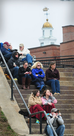 BRYAN EATON/Staff Photo. Fans sit on the steps as they watch the Newburyport High baseball team play their first game of the season hosting North Reading.