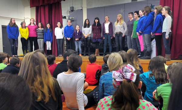 Amesbury: The Amesbury Middle School Melody Club, a choral group, performed for students at the Cashman School on Tuesday. The purpose of the visit was to provide information and generate excitement for the Cashman's  fourth-graders about the programs available to them when they enter the Middle School next year. Bryan Eaton/Staff Photo