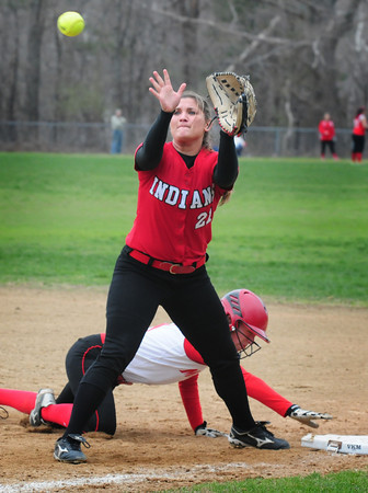 BRYAN EATON/ Staff Photo. The throw is a little late to Amesbury first baseman Zoe Fitzgerald as a Masconomet player heads back.