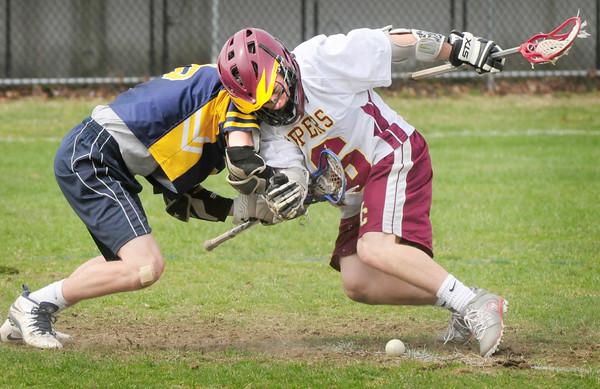BRYAN EATON/ Staff Photo. Newburyport's Adam Gardner battles with a Lynnfield player for the ball.