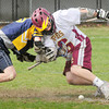 BRYAN EATON/ Staff Photo. Newburyport's Adam Gardner battles with a Lynnfield player for the ball.