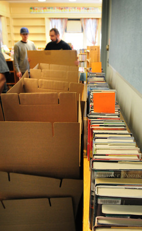 BRYAN EATON/ Staff Photo. Movers have been filling boxes with books at the Salisbury Public Library to move to a temporary location. The present library on the town common will be replaced with a larger structure.