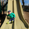 BRYAN EATON/ Staff Photo. Harry Callahan, 3, heads down a slide in what might be the last sunlight seen until Friday. The youngster from Newburyport was at Kelley School Playground with his mother Sunny on Monday afternoon.