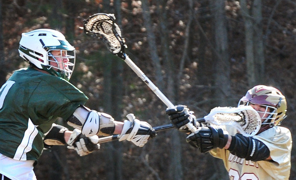 BRYAN EATON/ Staff Photo. Whittier's Rob Gramstorff, right, tries to defend against Pentucket's Jeff Porter.